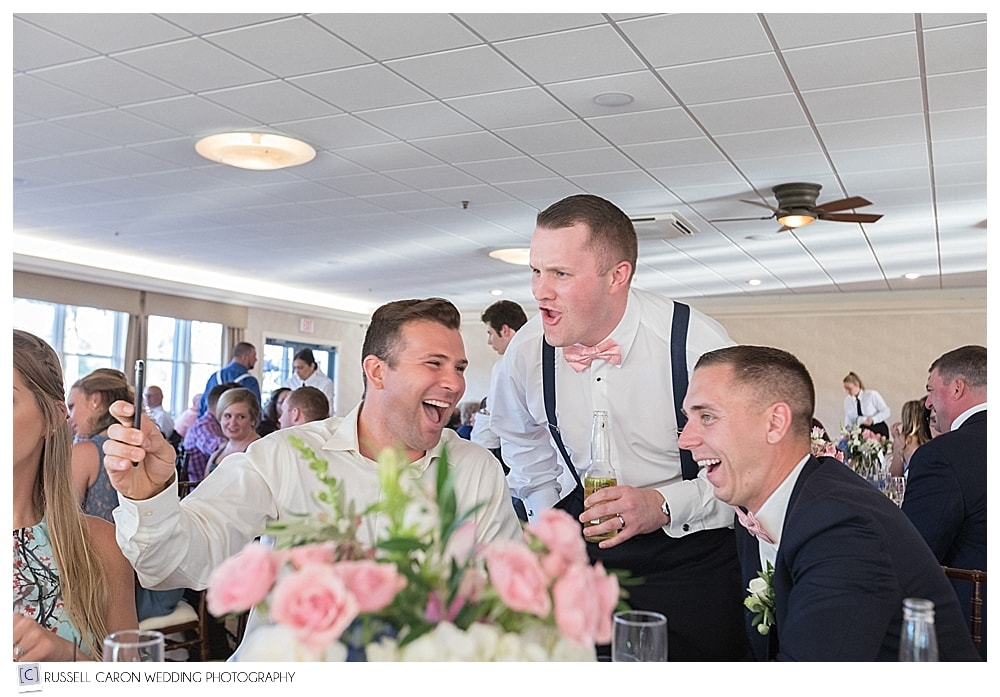 Groom and friends laughing