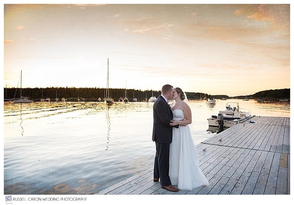 Bride and groom on the dock at Sebasco Harbor wedding