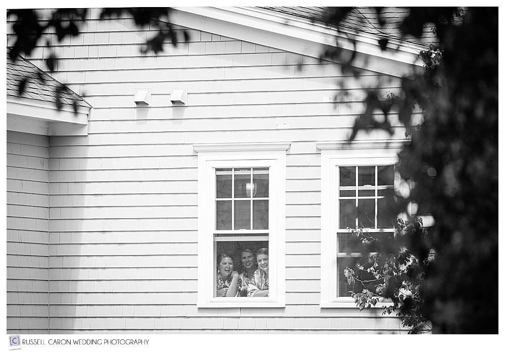 bridesmaids-peeking-out-window