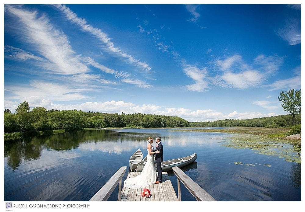 bride-and-groom-on-a-pond-dock