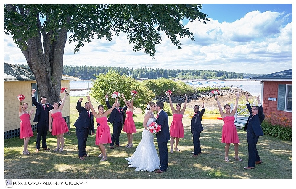 bride-and-groom-with-bridal-party-cheering