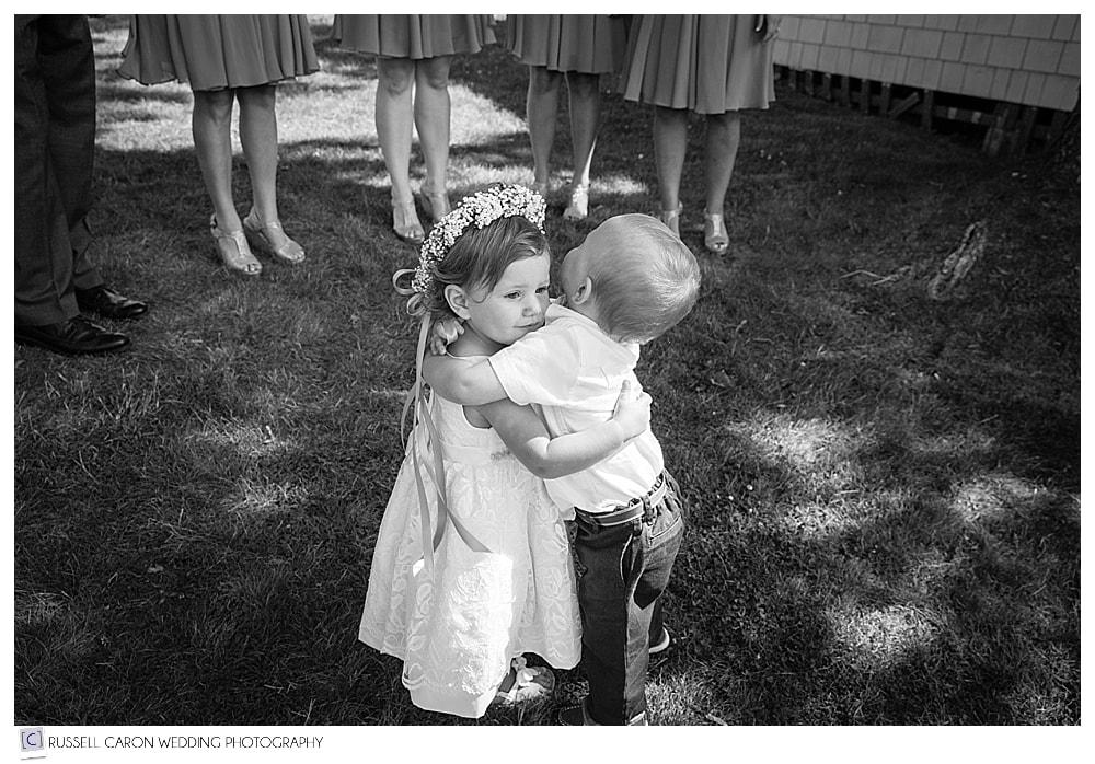 ring-bearer-and-flower-girl-hugging