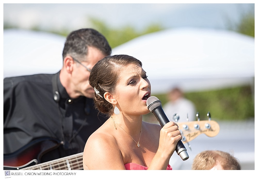 matron-of-honor-singing-during-ceremony