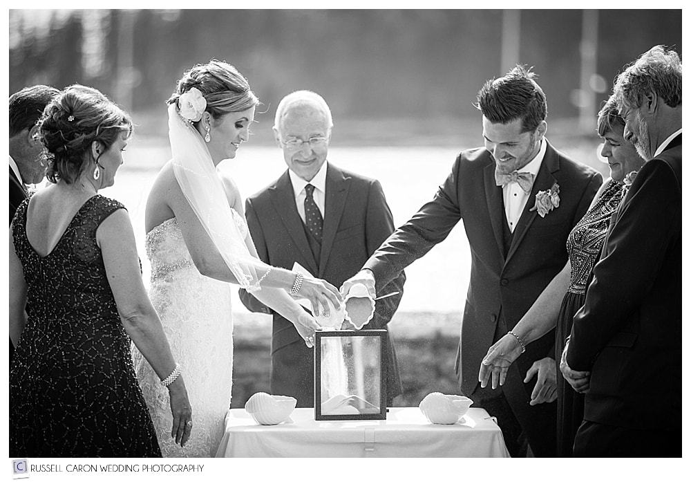 bride-and-groom-during-sand-ceremony