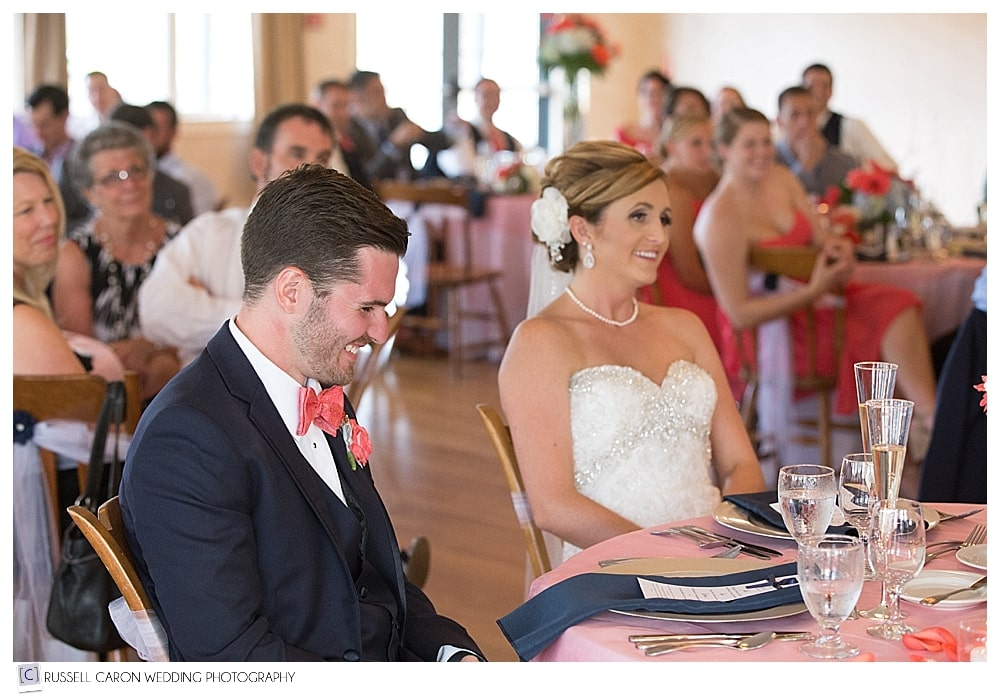 bride-and-groom-laughing-during-toasts