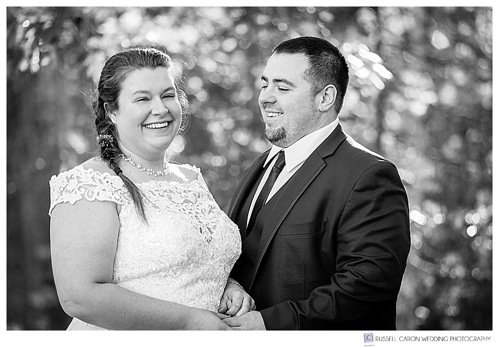 black and white photo of bride and groom standing together