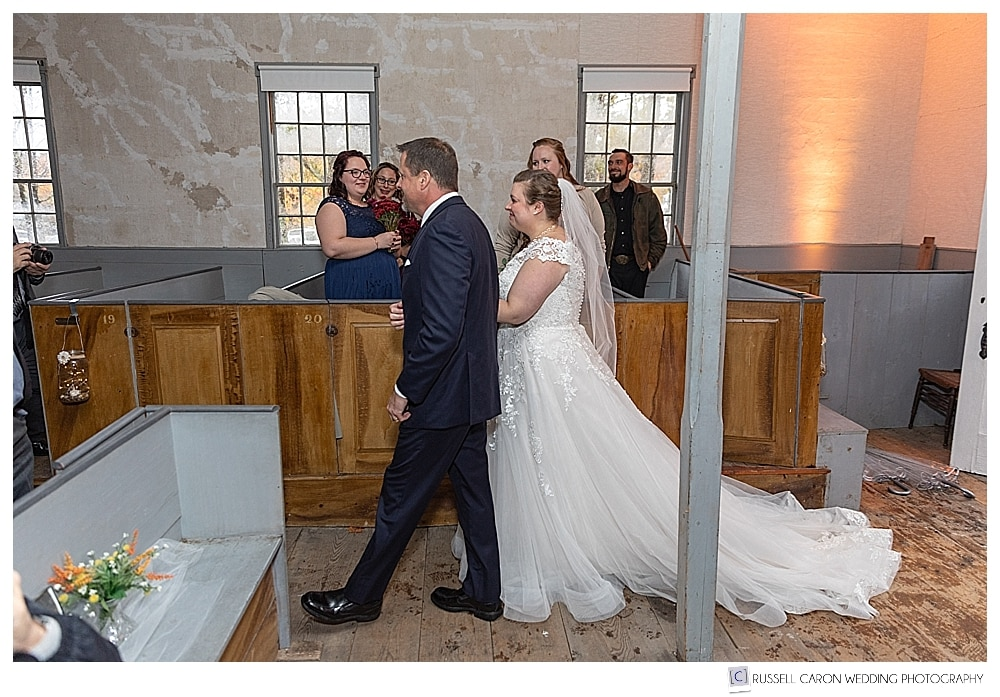 bride and her father enter the Elder Grey Meeting House at a southern Maine wedding