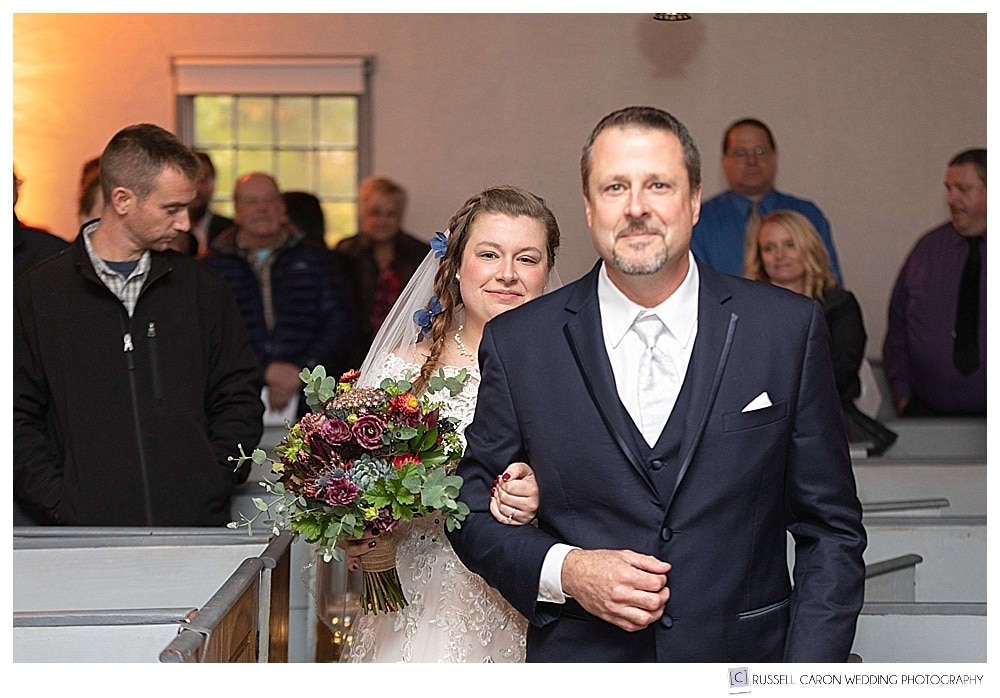 bride and her father walking down the aisle at the Elder Grey Meeting House in North Waterboro, Maine