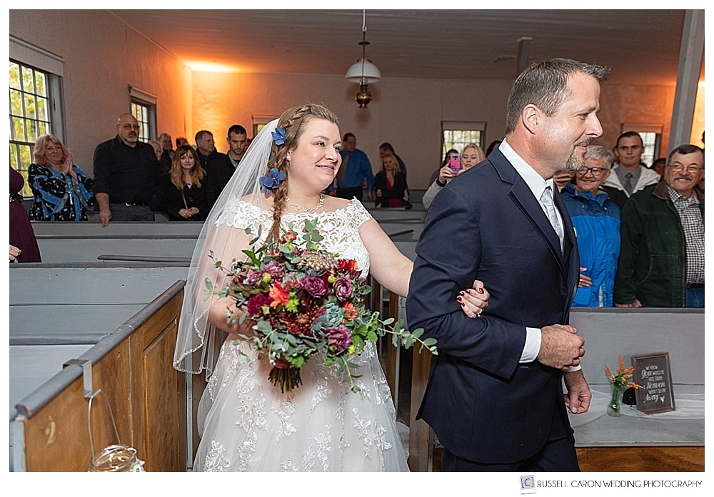 bride approaches the groom at the Elder Grey Meeting House, North Waterboro, Maine