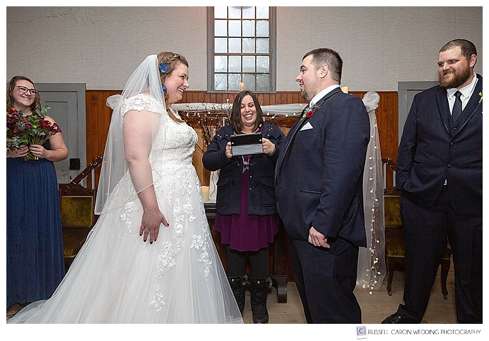 bride and groom during wedding ceremony at the Elder Grey Meeting House in North Waterboro, Maine