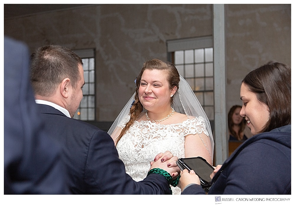bride and groom during hand fasting at southern Maine wedding ceremony
