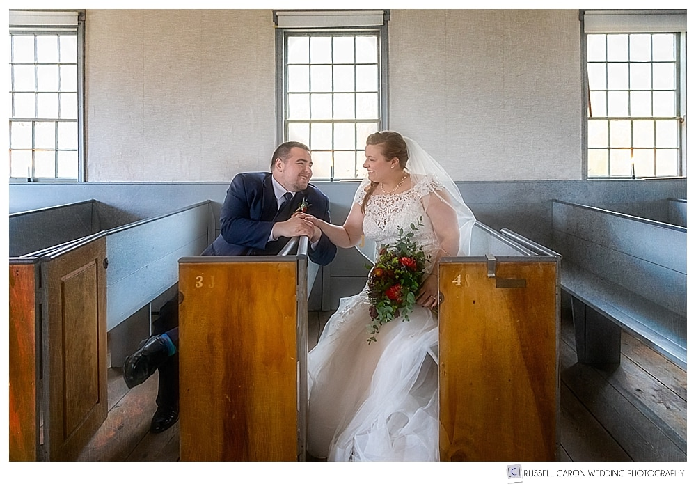bride and groom sitting in the Elder Grey Meeting House