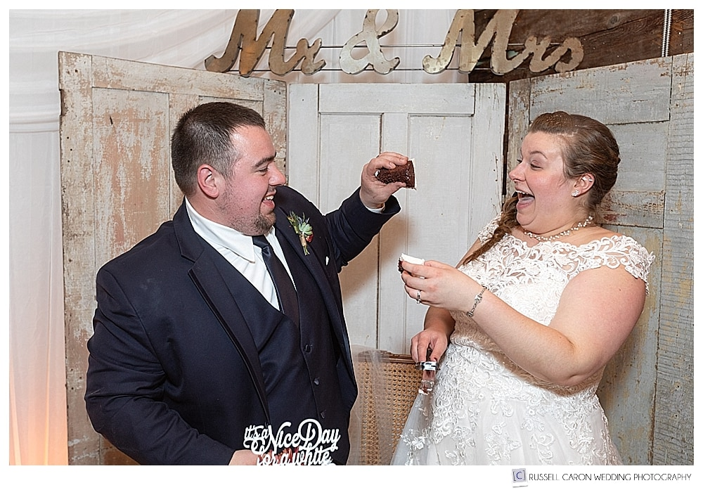 bride and groom about to feed each other with wedding cake
