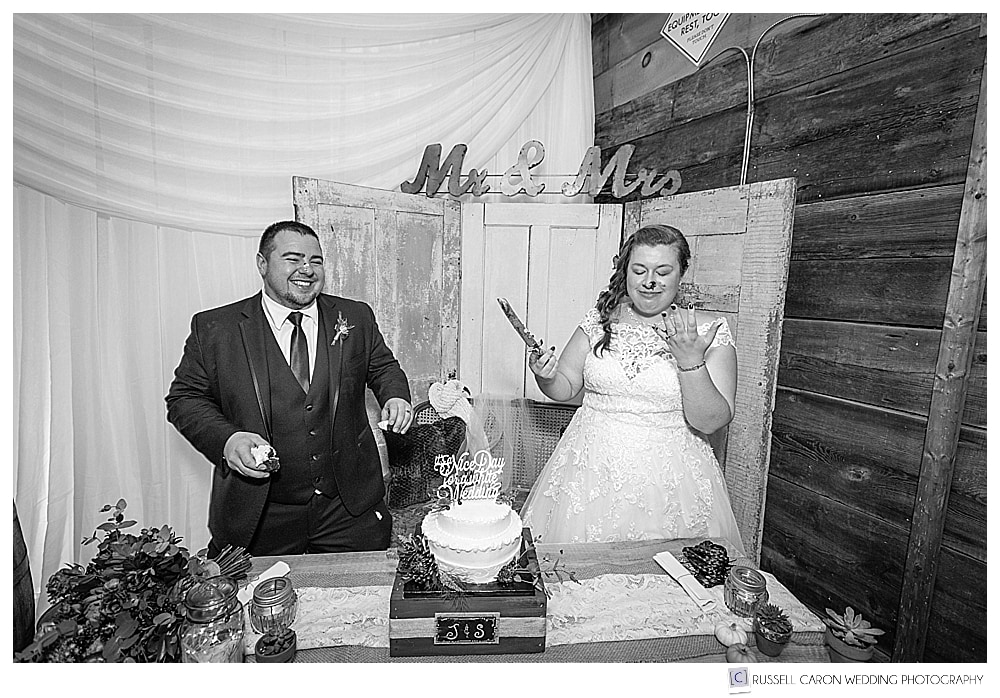 black and white photo of bride and groom after feeding each other wedding cake