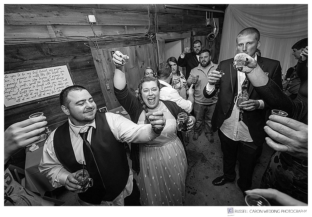 bride and groom doing shots at their southern maine wedding reception