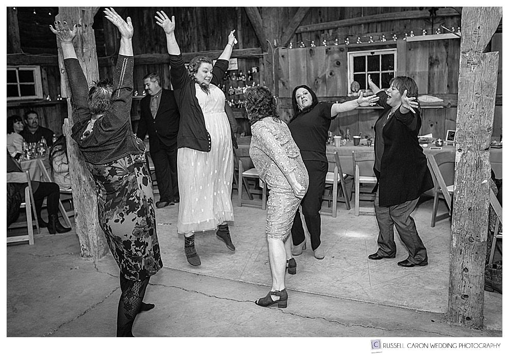 bride dancing with wedding reception guests