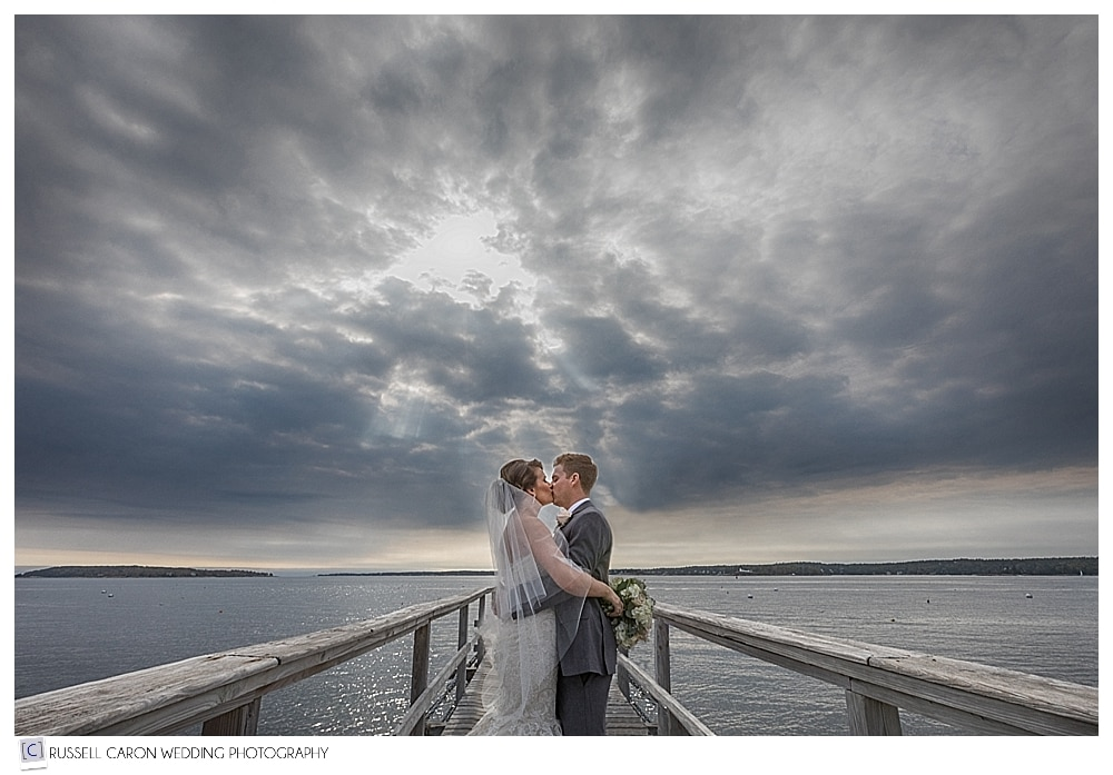 bride and groom on the dock at their Spruce Point Inn Resort wedding in Boothbay Harbor Maine