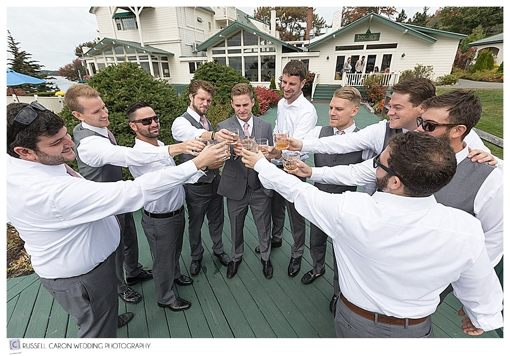 groom and groomsmen toasting with whiskey