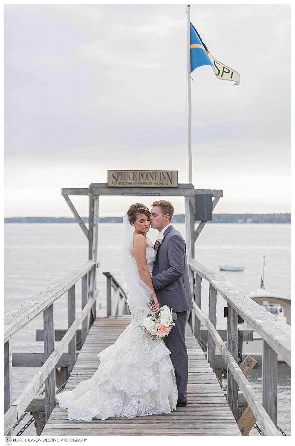bride and groom on the spruce point inn dock, Boothbay Harbor, Maine