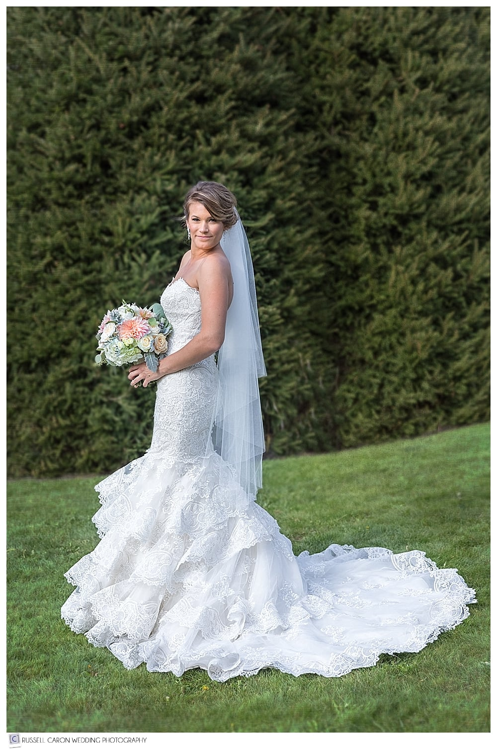 full length bridal portrait of bride wearing Allure bridals gown