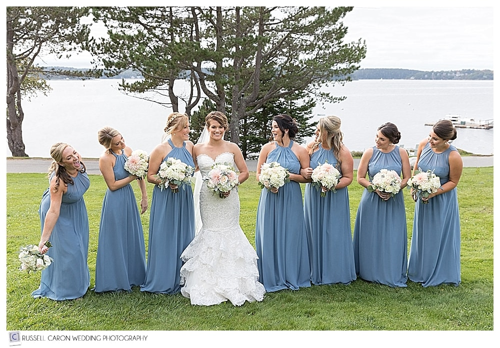 bride with bridesmaids on the lawn of the Spruce Point Inn, Boothbay Harbor, Maine