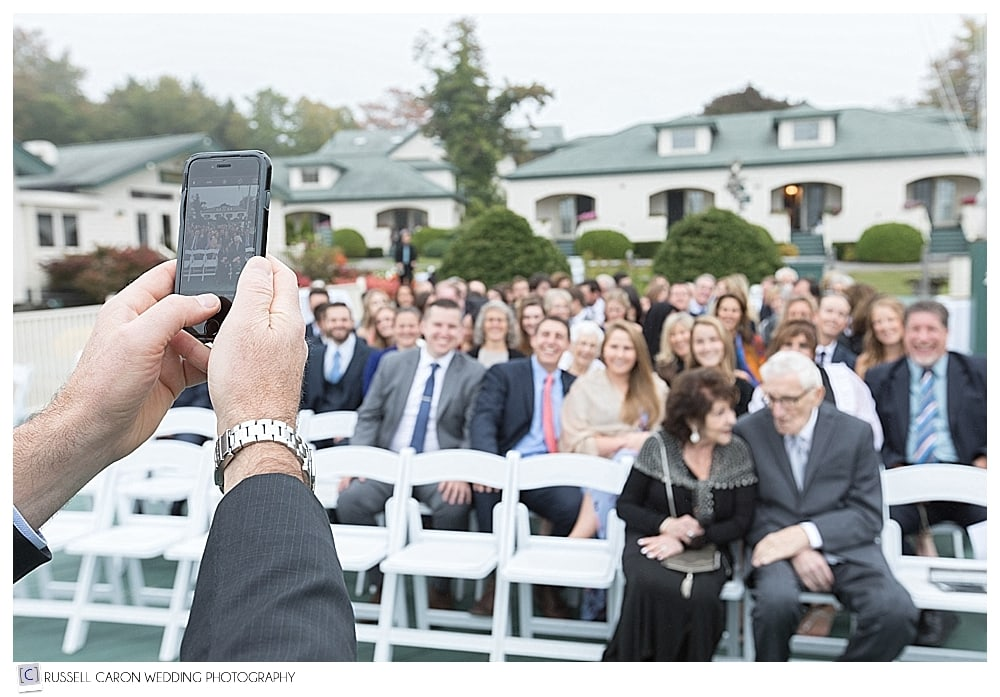 wedding guest taking a photo with phone