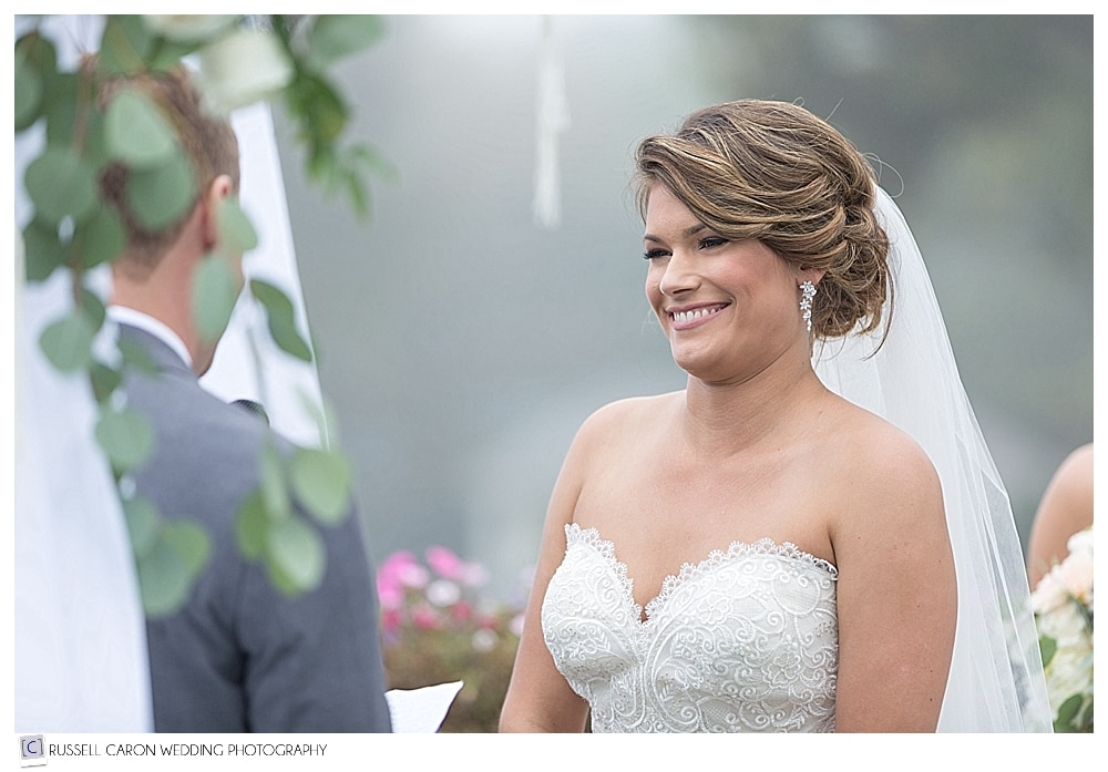 bride smiles during wedding ceremony