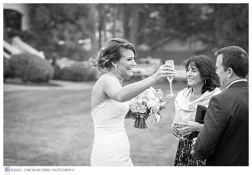 bride toasts with champagne