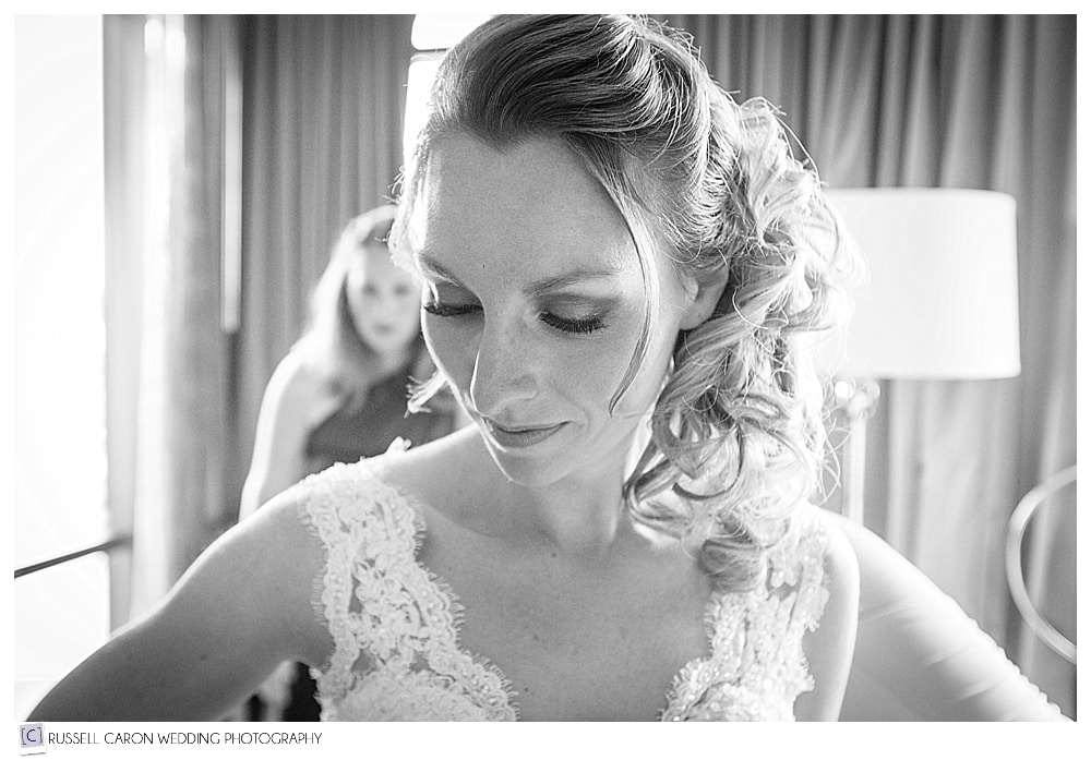 bride getting into gown