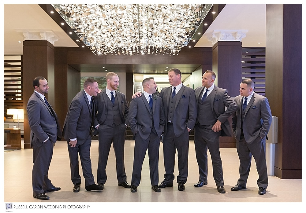groom and groomsmen in the lobby of the Westin Portland Harborview