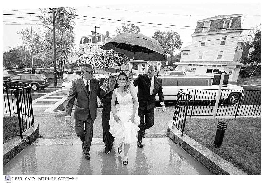bride under umbrellas