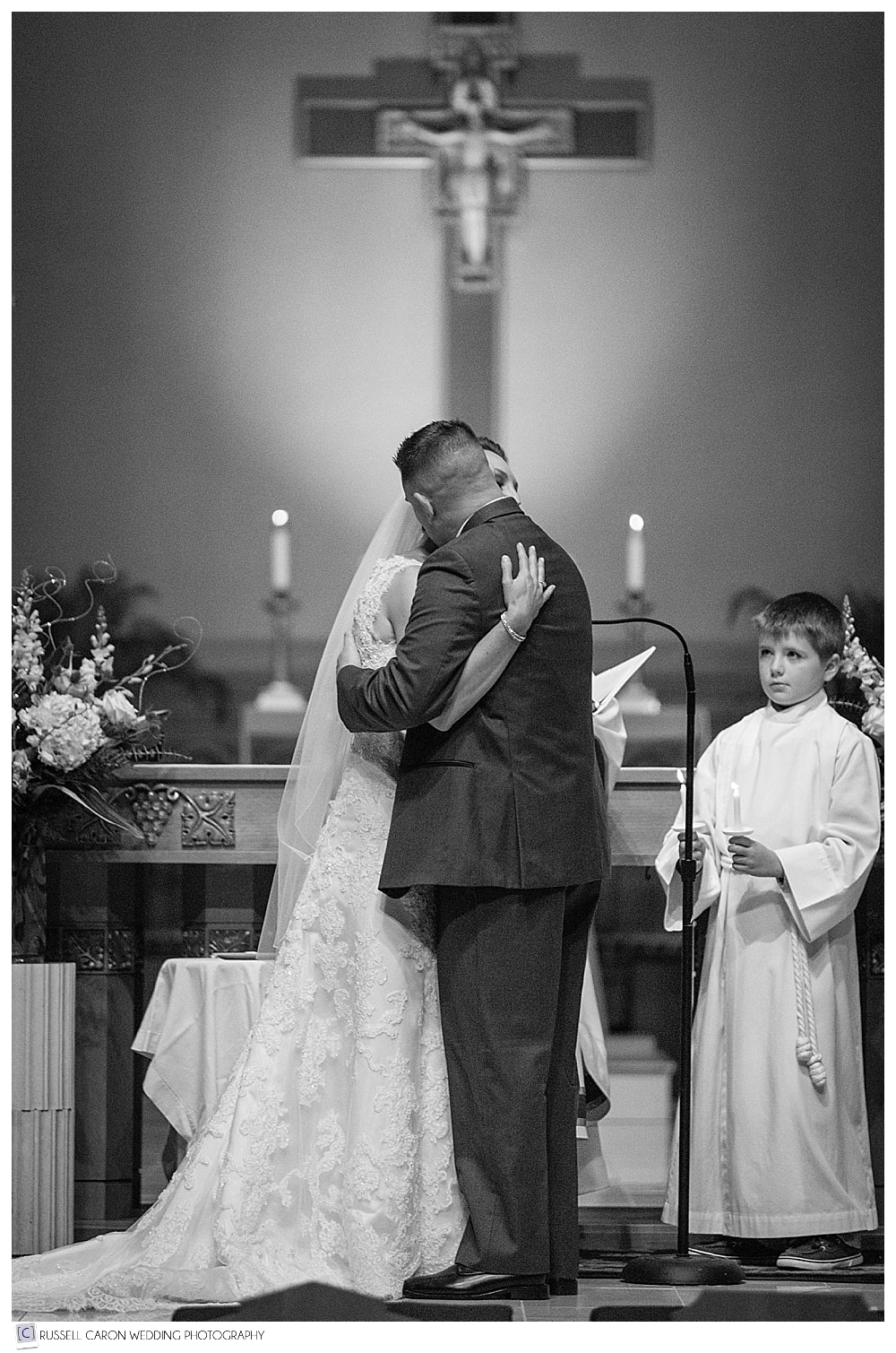 bride and groom hugging at the altar