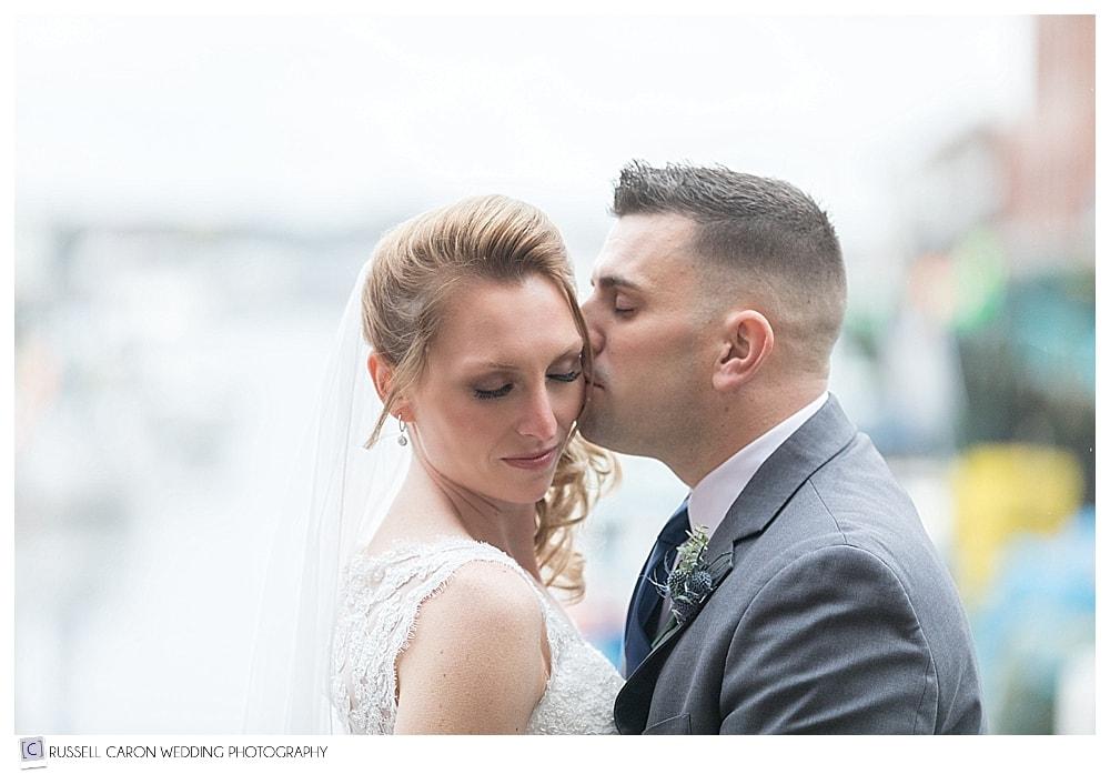 groom kisses bride