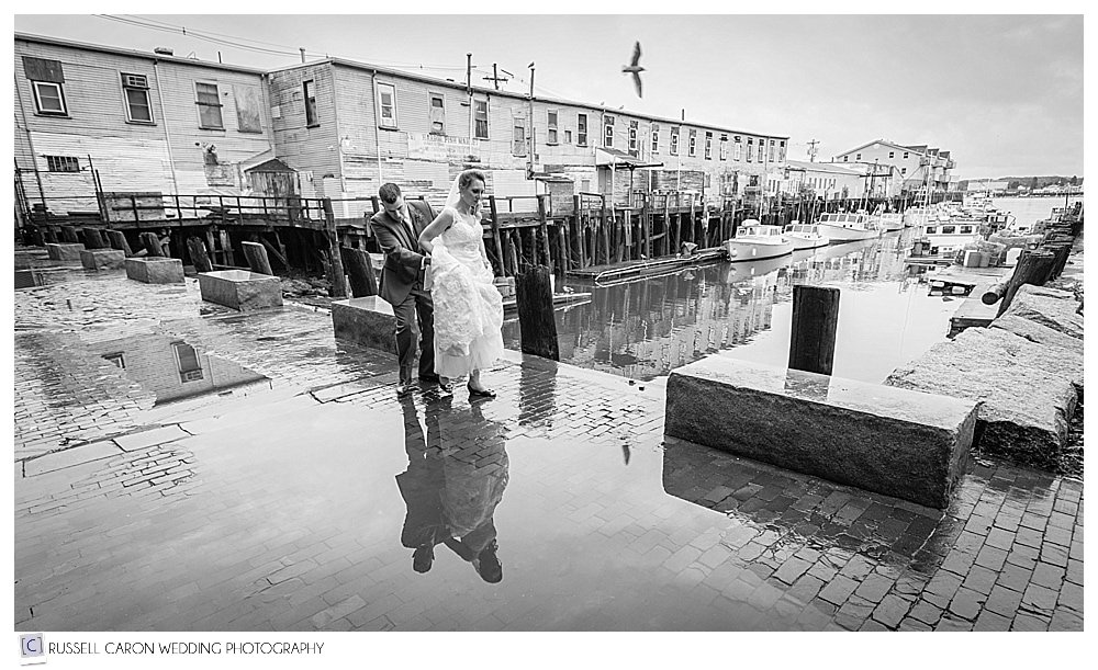 bride and groom walking on the Portland Maine waterfront