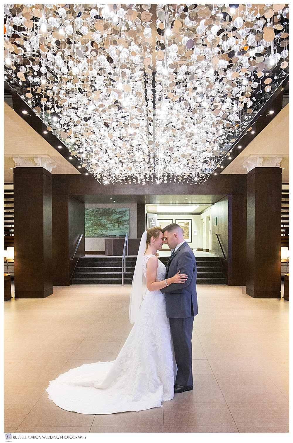 Bride and groom in the lobby of the Westin, during their Westin Portland Harborview wedding