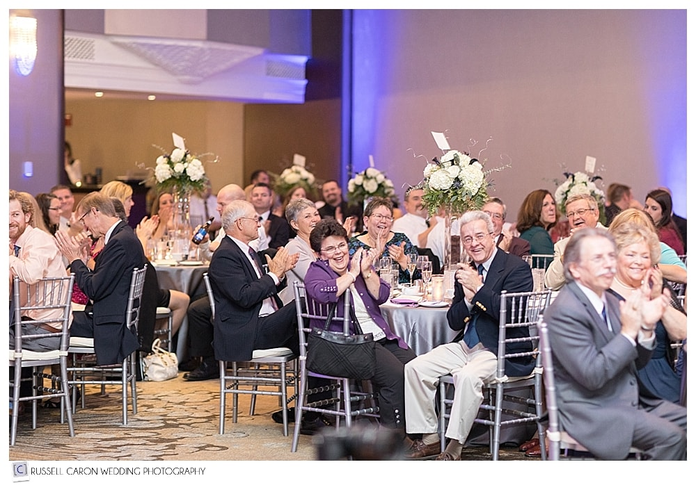 wedding guests during reception toasts
