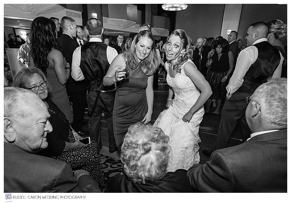bride and sister dancing together