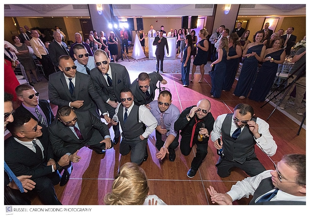groom and groomsmen dance for the bride