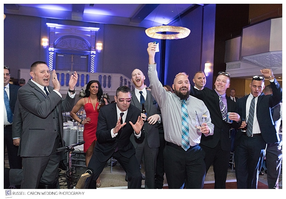 guests during wedding day garter toss