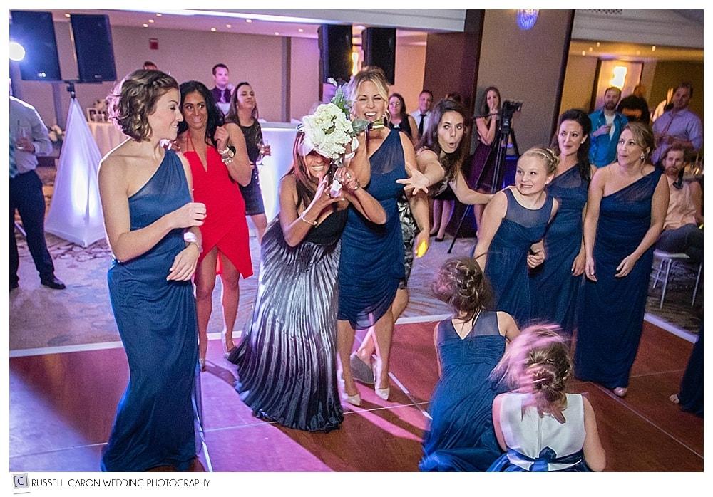 wedding guest catches the bridal bouquet