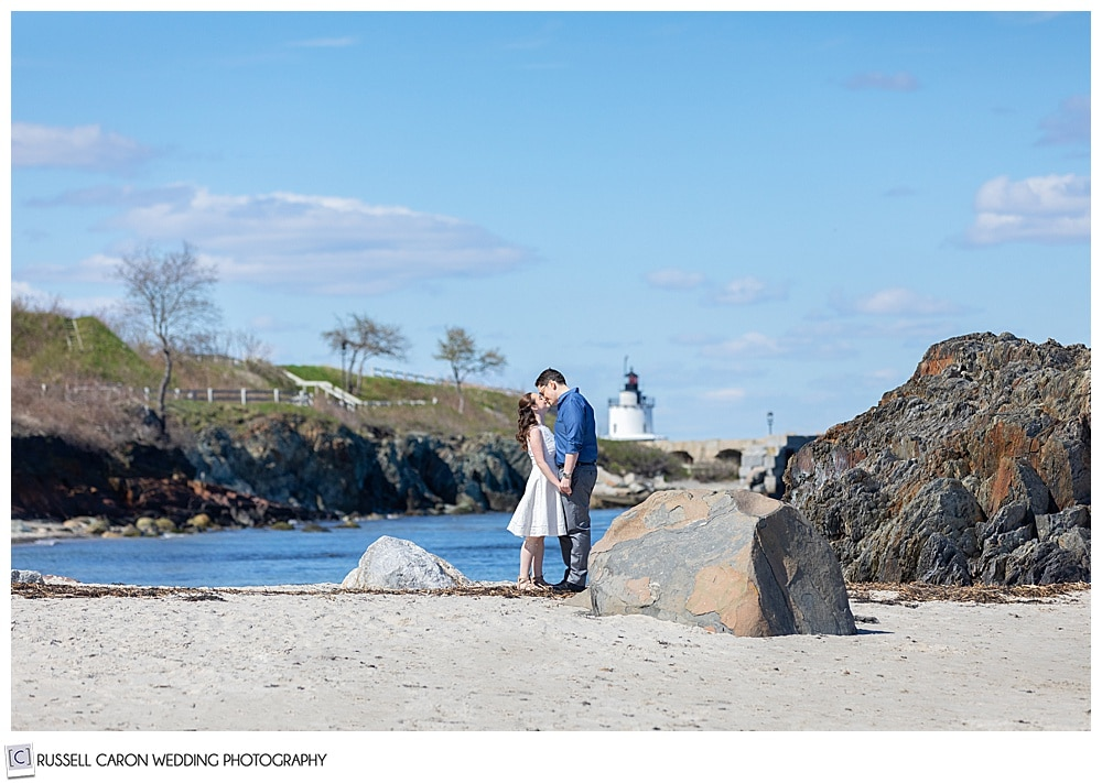 a couple is kissing at their willard beach engagement