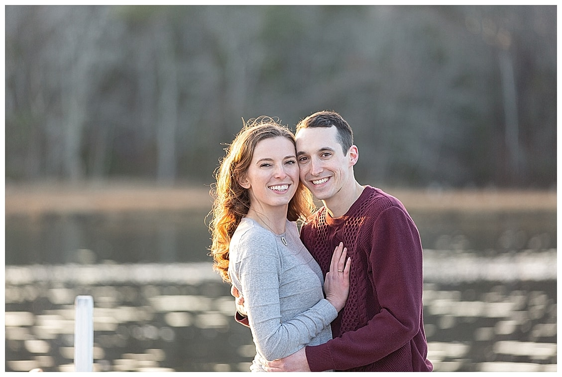 man and woman standing together, during their winter kennebunkport engagement session