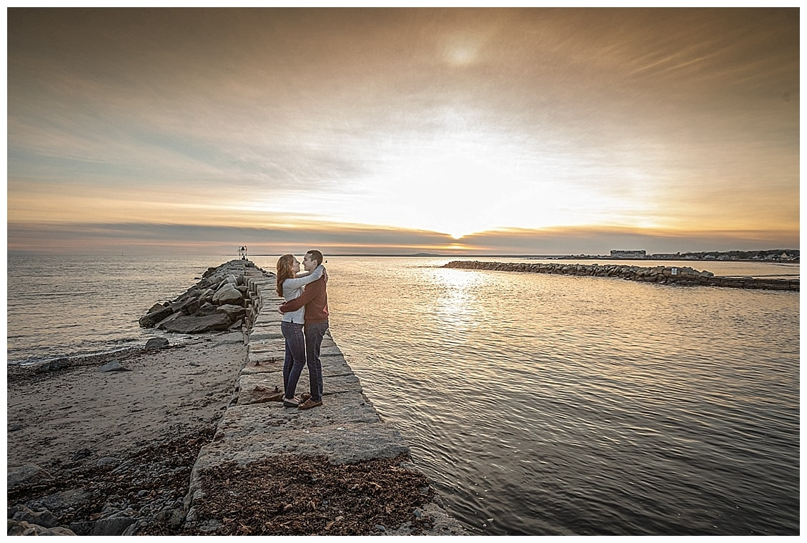 woman and man hugging each other on the Kennebunkport, Maine, breakwater
