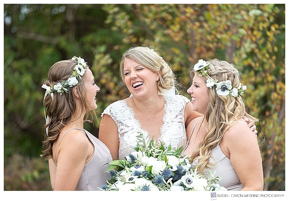 bride and two bridesmaids laughing together