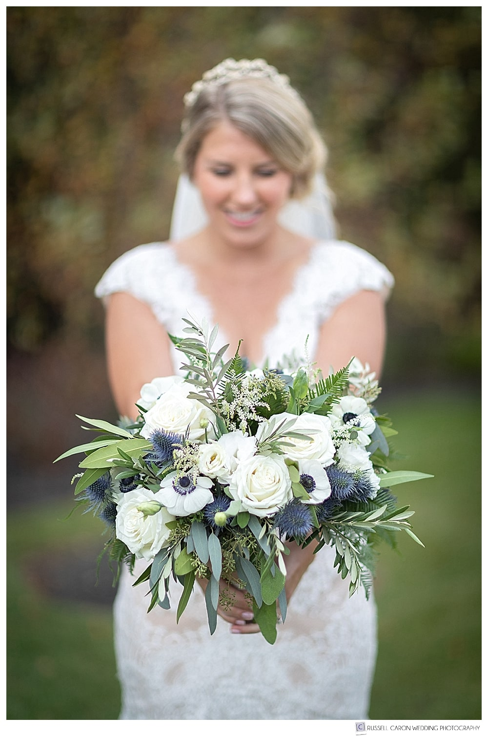 bride holding white, green and blue bridal bouquet from York Flower Shop