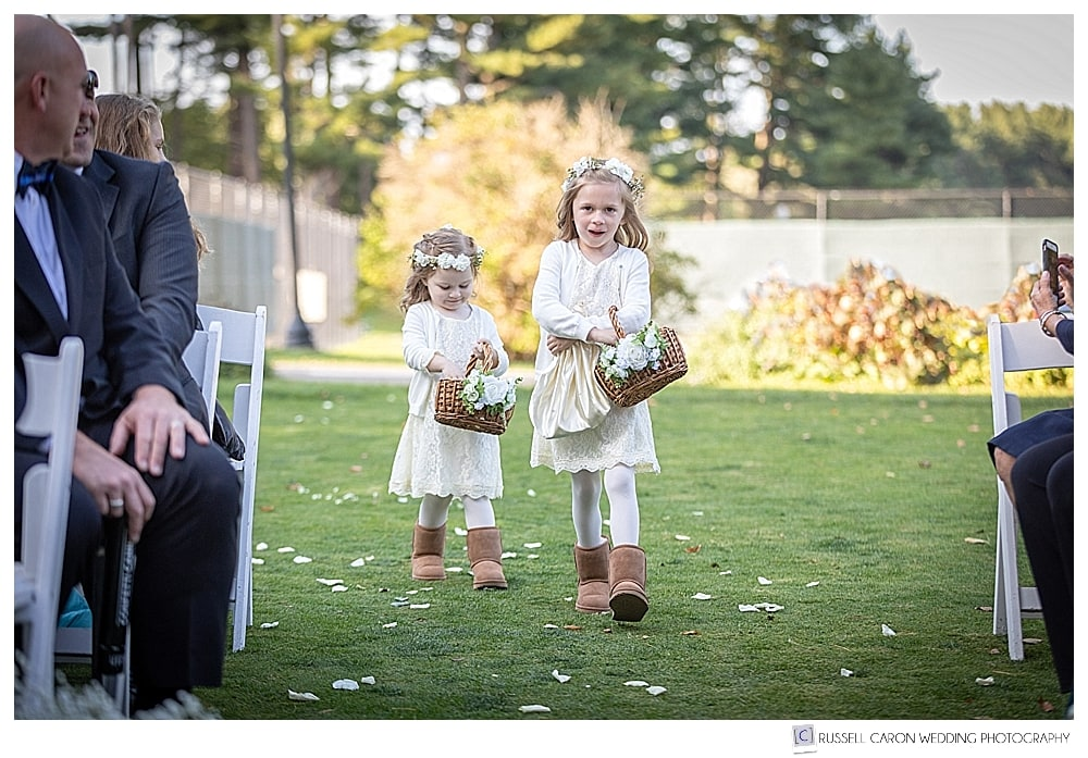 two flower girls walking down the aisle in an outdoor York Golf and Tennis Club wedding ceremony