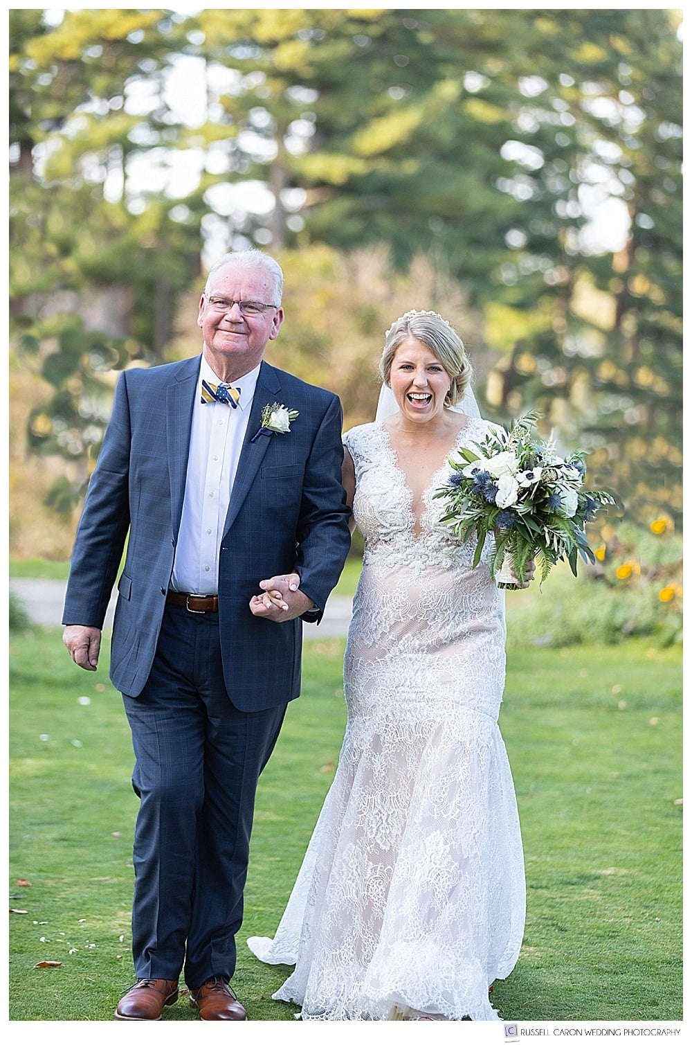bride and her father walking down the aisle at an outdoor York Golf and Tennis Club wedding ceremony