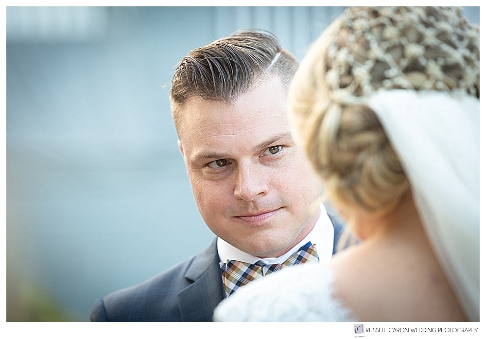groom looking at bride during wedding ceremony