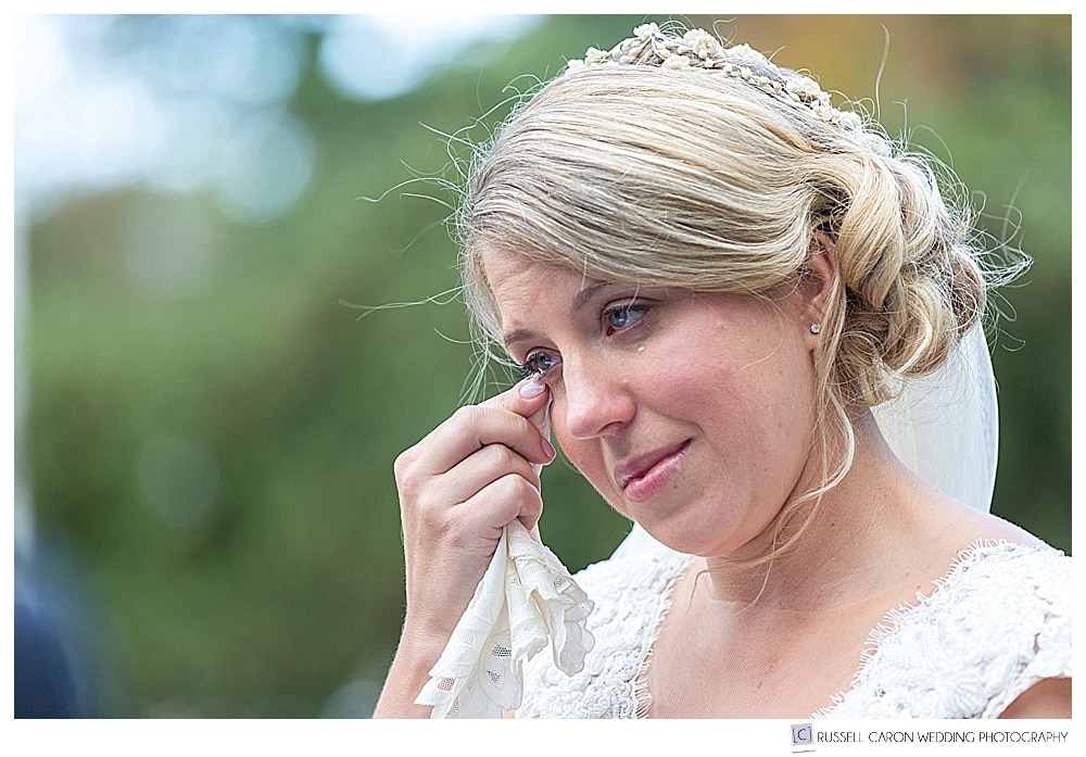 bride wiping a tear