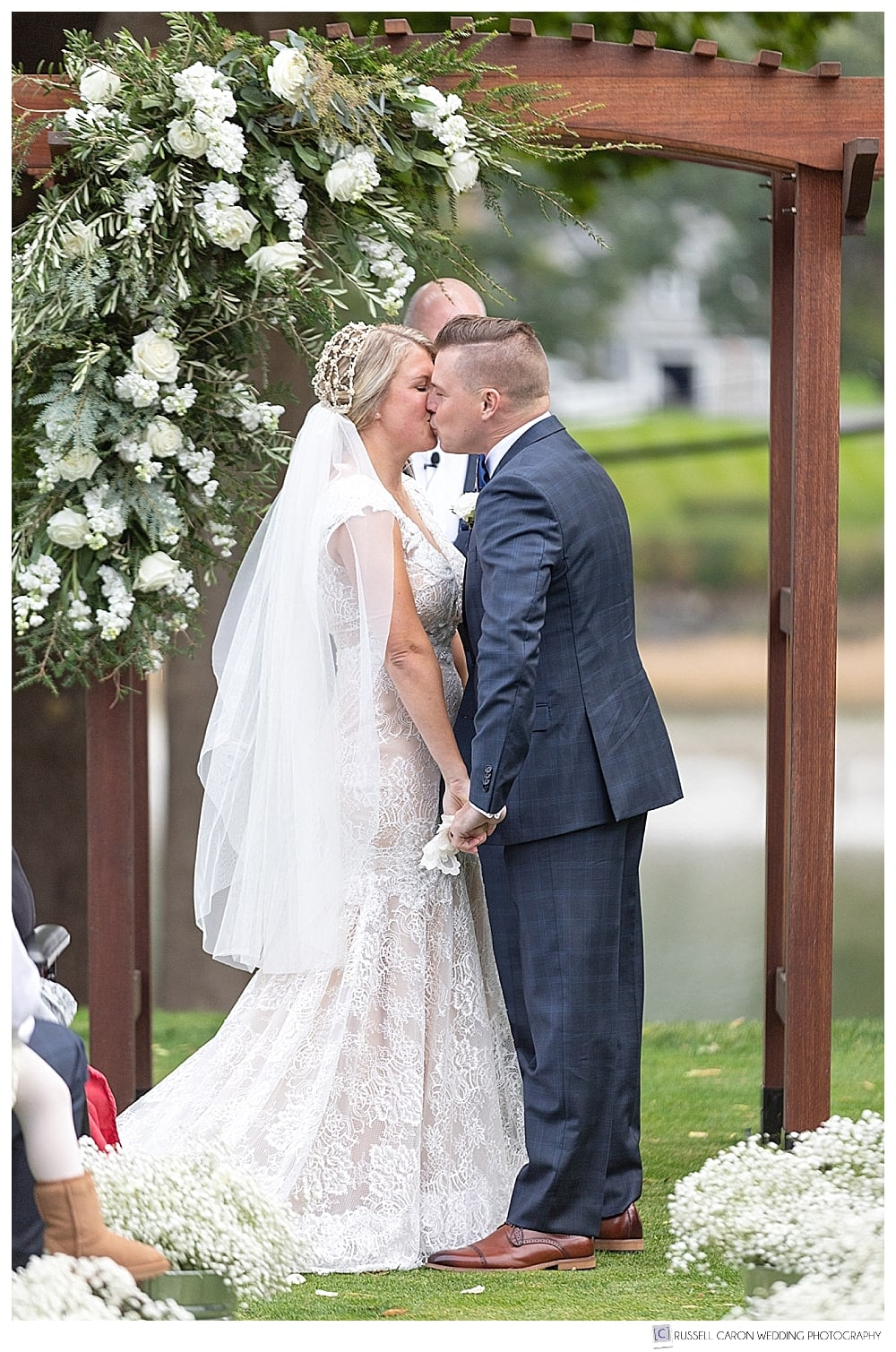 bride and groom's first kiss at their York Golf and Tennis Club wedding ceremony